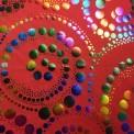 Lycra imprimé spirale multicolore fond rouge