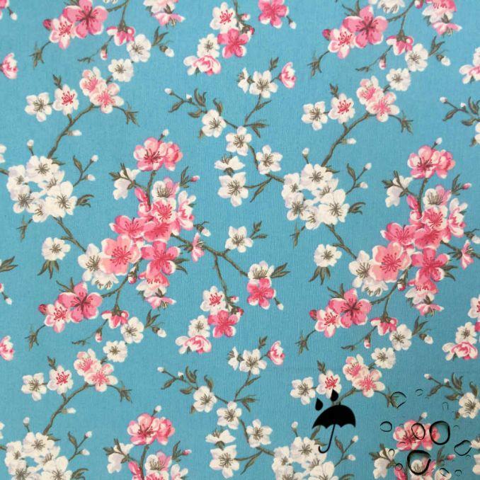 Tissu enduit fleurs japonaises fond bleu