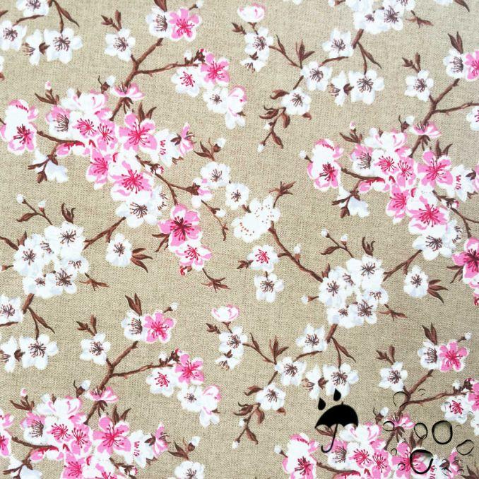 Tissu enduit fleurs japonaises fond beige