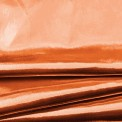 Tissu lamé orange au rouleau
